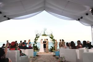 "Love.Style.Events, Miami — This wedding was featured on TNT's ""Wedding Day"". We erected a beautiful tent on Miami Beach which was draped and filled with fabulous lounge furniture. You can not beat the ocean as a backdrop!!! Call us today to see how we can make your dream wedding come true!"
