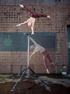 Darren Bersuk - Professional Acrobat, Vancouver — Double pose embedded, Burgundy Costume.