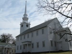 First Church of Christ, Congregational, 1652 - Meetinghouse, First Church of Christ, Congregational, 1652, Farmington — Our Meetinghouse was completed in 1772, and features a high pulpit and center aisle of 38 feet. The Meetinghouse has a capacity of up to 700 people, including the balcony seating. In the background you can see Amistad Hall, which includes our reception room, Sarah Porter Memorial Hall, which was built in 1901.