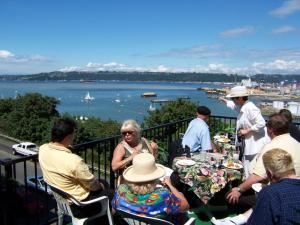 The Palm Room, The Mansion On Broadway, Tacoma — Ms Miller and The Lakewood Chamber of Commerce on the Palm Room Deck