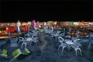 Outdoor Patio, Ghostbar - Las Vegas, Las Vegas — Outdoors, the dramatic sky-deck provides almost a 360-degree view of Vegas at its most glittering, with a glass inset in the floor offering a jaw-dropping view straight down. Posh seating areas are enhanced with fiber-optically lit drink rail running most of the circumference of the deck.