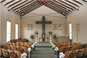 Wedding Chapel, Special Moments Chapel, Lewisville — Our beautifully decorated chapel can accommodate up to 100 guests. Complete with decorative pew markers, a 15 candle candleabra, and tea lights that create a very charming, romantic ceremony.
