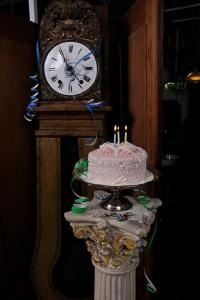 Restoration Resources, Boston — Integrate our vintage decor such as an old grandfather clock and/or column to display a cake and celebrate birthdays or anniversaries or retirement celebrations.