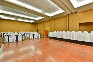 Winspear Ballroom West, iHOTEL 67 Street and Spa, Red Deer — 2500 square feel of uninterrupted space with 14 foot ceilings. A portable dance floor can be configured to any shape with options for stage and head table. Podiums are complimentary as is Internet access.