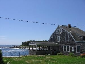 Grounds, The Driftwood Inn, Bailey Island — View of driftwood building to ocean