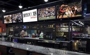 Entire Facility, SKYBOKX 109 GastroSports, Natick — The granite bar surrounded by flat-screen TV's at SKYBOKX 109.