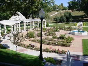 Rose Garden, Sioux City — The Rose Garden is perfect for a small outdoor wedding complete with a fountain, trellis, and plenty of roses.