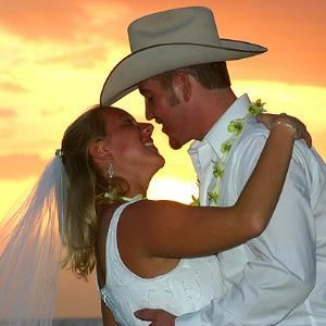 Merry Maui Weddings & Vacations, Kihei — Let a fiery Maui sunset be the backdrop at your dream beach wedding.