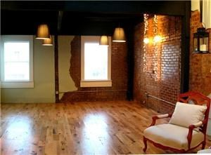 Loft Rental Starting From $375, The Loft At 14th, Concord — This space has it all including but not limited to beautiful light fixtures, hardwood floors, bold furniture, exposed brick walls, a huge skylight, wooden beams, a very modern kitchen and much, much more!!!