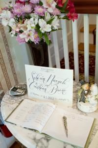 Grand Foyer, Main Street Manor Bed & Breakfast Inn, Flemington — Personalize your wedding with a guest book and favors displayed in our grand foyer to greet your guests as they arrive for your special day...