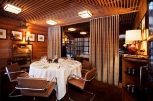 Humidor Room, Aretsky's Patroon, New York — Our Humidor Room, which is located on the second floor of the restaurant, can accommodate up to 8 guests at one round table