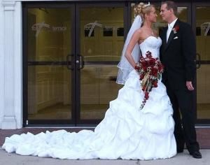 King's Court Gowns, Bartow — This is a testimonial photo from one of our happiest brides.  You view more testimonial and replica photos at www.kingscourtgowns.com.