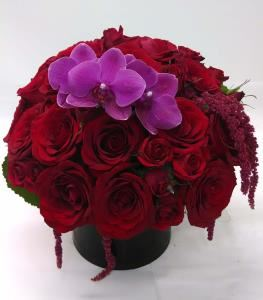 Edelweiss Flower Boutique, Santa Monica — One of our lavish designs of rich red roses, garden red roses, spray roses, purple butterfly orchid bloom and hanging amaranths.  We can do it all!  Impress your girl or guy with something lavish.