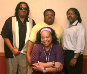 Basic Truth, Cincinnati — Basic Truth is (standing, l-r:) Bill Dandridge (bass, keyboard, vocals), Wes Dandridge (drums), MarTinez Butts (guitar, keyboard, vocals); (seated, center:) C.C. (lead vocals)