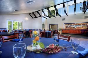 Banquet Room Minimums, Blue Prynt Restaurant & Bar, Sacramento — Blue Prynt Banquet Room featuring vaulted ceiling, sky light windows and french door windows with balcony.