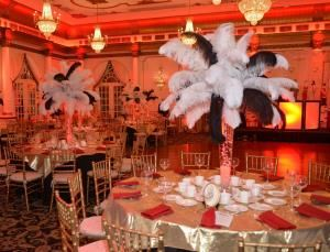 Flying Frog Events, Monroe Township — Our elegant Great Gatsby theme can be the setting of a corporate, non profit or Sweet 16, Bar/Bat Mitzvah complete with room & table decor, ambient lighting as well as our costumed greeters handing out pearl necklaces & feathered headbands to the ladies & fedoras to the gentlemen. Our costumed dancers will perform & teach your guests the hottest dances from the Great Gatsby era.
