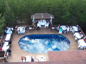 Blue Lagoon Deck, Cavender Castle, Dahlonega — The Blue Lagoon is a lovely, private outdoor deck complete with a fountain.  Perfect for receptions and private parties.  A bar or buffet can be set up under the awning.