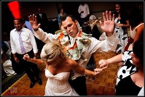 The ORIGINAL Mr. DJ, Chicago — The money dance, dollar dance, or apron dance is an event at some wedding receptions in various cultures. During a money dance, male guests pay to dance briefly with the bride, and sometimes female guests pay to dance with the groom. The custom originated in Poland in the early 1900's in immigrant neighborhoods.   Sometimes guests are told that the money will be used for the bride and groom's honeymoon or to give them a little extra cash with which to set up housekeeping. Typically these dances are done as a slow dance; however the Original Mr. DJ from time to time has changed this to a faster dance in order to speed up the time frame from dancing with nearly everyone in the room and going through numerous slow dance songs and narrowed it down to one. Again, it's your wedding and every wedding has its own special flavor and needs.  http://theoriginalmrdj.com/Dollar_Dance.html