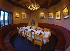 The Tower, The Fort, Morrison — The Tower seats up to 16 guests, comfort capacity is 10 guests.  It houses a romantic beehive fireplace and an antler chandelier.  The Tower is great for intimate dinners and small business meetings.