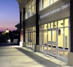 BancorpSouth Conference Center, Tupelo — Side view of the BancorpSouth Conference Center at dusk. The old Tupelo Courthouse is in the background.