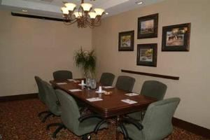 Board Room, Hampton Inn & Suites Legacy Park-Frisco, Frisco — Our Board Room can seat up to eight people for your small meetings. A flip chart and screen are provided with room rental.