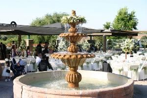 Fountain Terrace, Thornton Winery, Temecula — Thornton Winery's Fountain Terrace is centered between their Gift Shop, Champagne Lounge and Café Champagne. During a warm summer day, you will often find a flower girl or ring barer throwing pennies into the fountain while their families celebrate a new marriage.