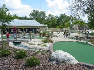 Ace Golf Range & Family Fun Center, Riverview — Party Barn overlooking Tropical-themed Miniature Golf Course