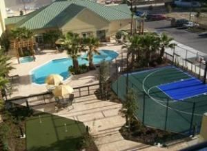 Homewood Suites by Hilton - Ocala at Heath Brook, Ocala — Spacious outdoor courtyard with heated swimming pool, whirlpool, sports court and putting green.