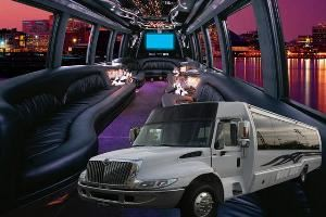 "Limousines By Liz, Lynnfield — 26 passenger Luxury Limo-coach with 44"" & 15"" TV's Satellite TV, Karaoke, surround-sound, 2 large ice bins/bars, super A/C and more!"