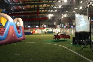 Richmond Indoor Sports Experience (RISE), Midlothian — Field with party rentals set up