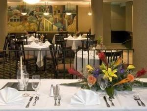 Carnevale Cafe, Embassy Suites Tysons Corner, Vienna — Savor fine cuisine in the casual ambiance of the Carnevale Café, our full service restaurant. Perhaps you have work to do and don't have time to stop, then feel free to call us and have room service delivered until 11pm.