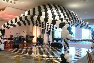 The Original Balloon Shoppe, Laguna Hills — Balloon Canopy made with 11 inch latex balloons in black and white to match the dance floor.