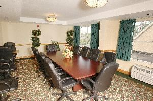 Boardroom, Country Inn & Suites Orlando - Universal, Orlando — Our comfortable boardroom seats up to 15 guests. Wet bar in room with mini-refrigerator.  Coffee, soft drinks, bottled water and Audio/Visual equipment available upon request.  A fee is required.  Contact us today for availability and rates.