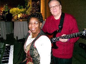 "THE ANTONELLI DUO-SHASHANA & ROLANDO-KEYBOARDS/SYNTH & GUITAR--""THE SOUND OF 4--THE PRICE OF 2"", Richmond — THE ANTONELLI DUO--SHASHANA & ROLANDO--performing their beautiful SOOTHING, SMOOTH JAZZ GARDEN MUSIC at the private party for special contributors to the Maymont Foundation at the Richmond Convention Center, Richmond, VA, February, 2008."