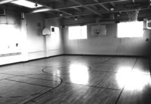 Gym, Multnomah Arts Center, Portland — The Gym is equipped with a basketball court with six hoops, wood floors, and ballet barres. It has 2400 square feet. It is available for dances, basketball, volleyball and fitness classes. No food or drink is allowed in gym. Chairs and tables are available upon request. The capacity is 100 people theatre style and 150 standing room.