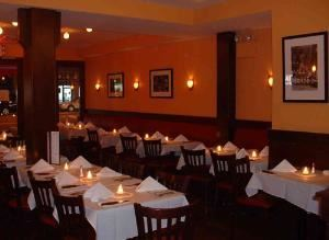 Talia's Steakhouse & Bar - Catering, New York — Your dining experience commences at Talia's Steakhouse door because Talia's ambiance guarantees an enjoyable experience. A special attention is given to color, aroma, noise level, movement, room's temperature and lighting. The quality of the fine dining cuisine is important, and so, too, is service and indeed, Talia's provides delectable cuisine and a impeccable service. But ambiance would be a very inportant part of your dining experience at Talia's classy-casual, fun atmosphere spot.