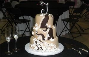 Art Eats Bakery, Greenville — Three tier fondant wedding cake with sugar butterflies and chocolate swirls.