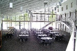 Main Hall, Our Lady of Perpetual Help Parish Center, Aurora — The Parish Center Main Hall is a open floor plan.  Floor to ceiling windows look out to the wooded grounds.
