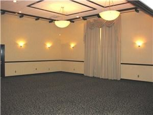 Quality Inn And Suites, Artesia, CA, Artesia — Elegant Banquet Hall with Wood, Ivory and Green earth tones.