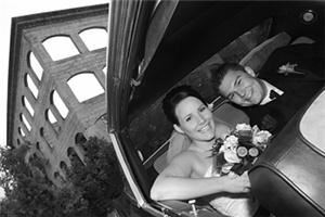J Kevin Dunn Photography, Kelowna — Happy Bride and Groom in the Limousine, Okanagan. Black and White Documentary style Photography.