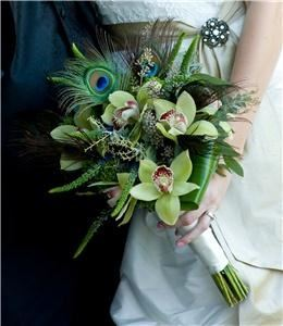 Monday Morning Flower & Balloon Company, Princeton — A funky, fun, yet elegant bridal bouquet of orchids, veronica and peacock feathers.