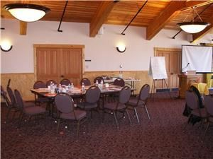 Long's Peak Meeting Room, Highlands Presbyterian Camp & Retreat Center, Allenspark — Long's Peak dining and meeting room is 48x38 ft with a spectacular view of Mt. Meeker which hides the higher Long's Peak.  It can be set a variety of ways to meet the exclusive dining and meeting needs of your group.