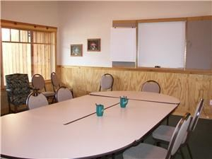 The Conference room, Highlands Presbyterian Camp & Retreat Center, Allenspark — The intimate conference room can accommodate up to 32 for meal service or up to 50 in theater style seating.  It is best suited for groups of 10-25 for exclusive meeting and dining.