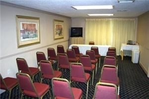 Conference Room, Best Western Palm Beach Lakes Hotel, West Palm Beach — Meeting room is located next to our 40 x 60 ft. lobby. Size of the room is 324 sq. ft. and it can accommodate up to 30 people in theatre style and 18 people in classroom or conference style. Meeting room has TV and DVD/VCR player, screen, dry erase board, wireless internet access and water station. Speaker phone is available upon request.