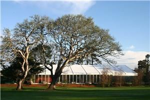 Celebrations Party Rentals And Tents, Roseville — Monterey CA Golf Course Structure tent with liner, lighting, air conditioning, glass walls, and a catering kitch inside of the tent.
