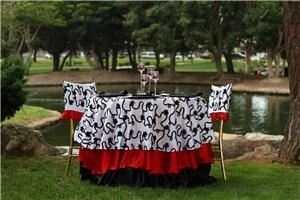 Bella Event Services, Costa Mesa — white and black ribboned taffeta overlay withe two layered satin linens (red and black), matching chair caps,