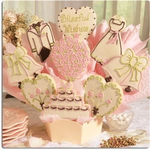 Cookies by Design - New York, New York — Create a lasting impression when you use this unique wedding bouquet as a gift for the new couple or as an edible table centerpiece for bridal showers, bridesmaid luncheons, or wedding receptions. Artfully hand-decorated in pearl, pink, spring green and a hint of brown, this beautiful wedding bouquet is sure to create a lasting impression for years to come.