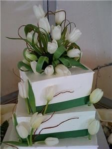 Minia's Bake Shop, Newark — Featured is our most sought out cake for this wedding season. It's a simple tulip design with wicker branch.