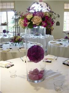 Enchanted Florist, Pasadena — Wedding centerpeice using orb suspended in cylinder.