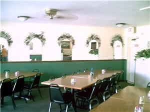Banquet Room, Zorba's Restaurant & Pizzeria, Debary — Private Banquet Room with beautifully finished hard oak tabletops. Tables can be rearranged to seat as many guests at a table as you wish. Ceiling fan which YOU control keeps everyone comfortable!